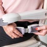 Handicare 1100 stair lift woman fastening seat belt