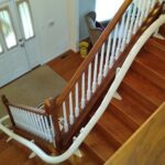 Handicare Freecurve curved stair lift curved rail on stairs