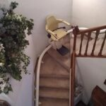 Handicare Freecurve curved stair lift going across landing