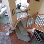 Handicare Freecurve curved stair lift parked at bottom