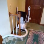 Handicare Freecurve curved stair lift with 180 degree park at top