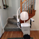 Harmar Helix curved stair lift parked at bottom