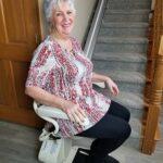 Harmar Pinnacle SL300 stair lift with person riding
