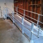 Wheelchair ramp leading to garage entry door