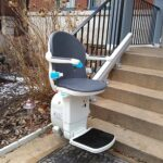 Handicare 1000 outdoor stair lift at bottom of front porch stairs