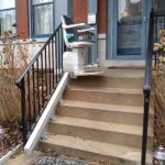 Handicare 1000 outdoor stair lift at top of front porch stairs