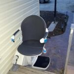 Handicare 1000 outdoor stair lift with seat swiveled at top