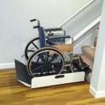 Harmar Sierra inclined wheelchair lift at bottom of stairs with wheelchair