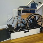 Harmar Sierra Inclined wheelchair lift with a wheelchair ready to exit