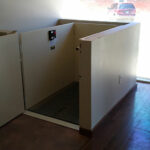 Commercial wheelchair lift at local business with door open