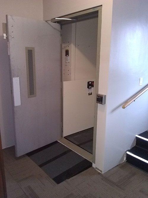 Commercial wheelchair lift with door open
