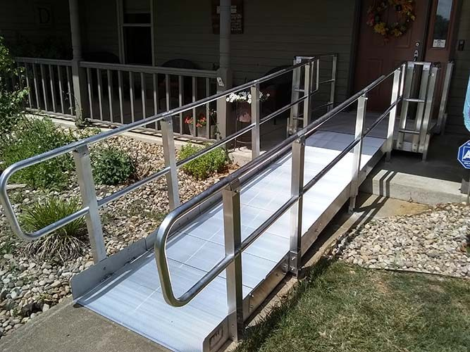 Wheelchair ramp leading to the front door of home