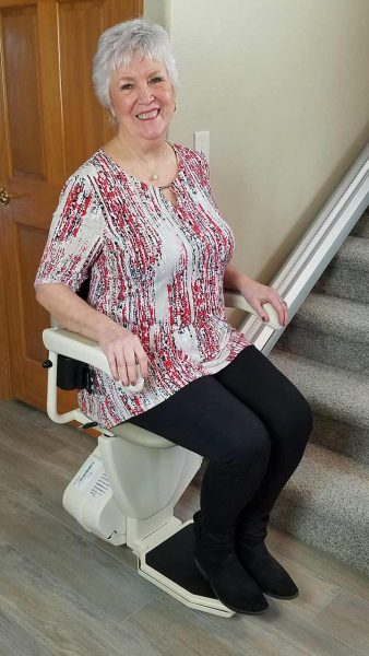 Woman riding stair lift