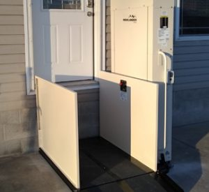 Highlander vertical wheelchair platform lift in the down position installed by Options HME in Centralia Illinois